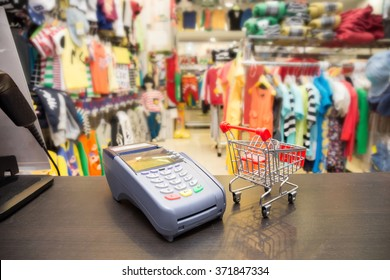 Credit Card Machine With Shopping Cart In The Store