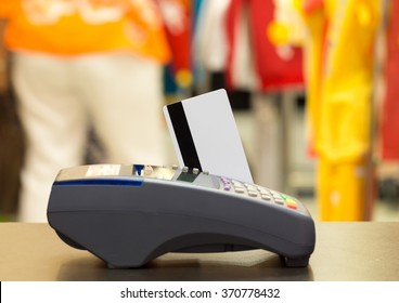 Credit Card With Credit Card Machine In The Store : Selective Focus