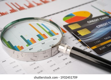 Credit card with Magnifying glass on chart and graph paper. Finance development, Banking Account, Statistics, Investment Analytic research data economy, Stock exchange trading, Business company.