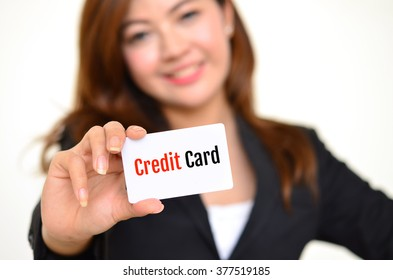 Credit card, message on the card shown by a businesswoman