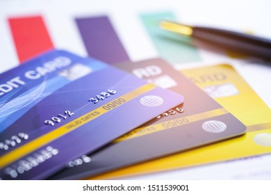 Credit card model on chart and graph spreadsheet paper. Finance development, Banking Account, Statistics, Investment Analytic data economy, Stock exchange trading, Business company concept.