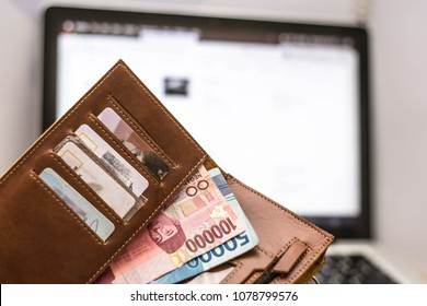 credit card with monitor showing e commerce, online transaction, wallet with card and rupiah money