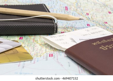 credit card ,Notebook and passport on map