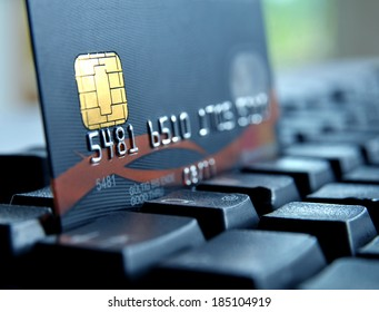 Credit card on a black computer keypad
