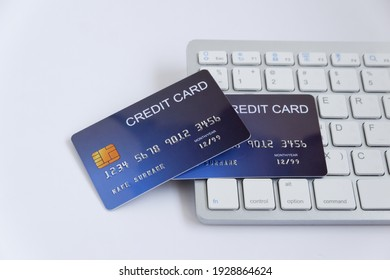 Credit card on computer keyboard on white desk. Concept of Online shopping and payment.