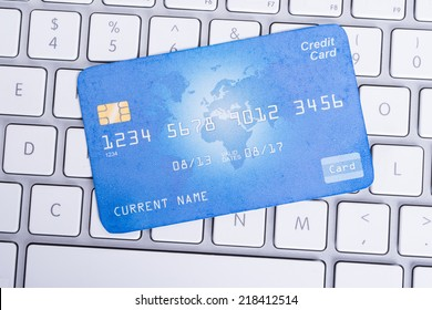 Credit card on computer keyboard in online shopping concept