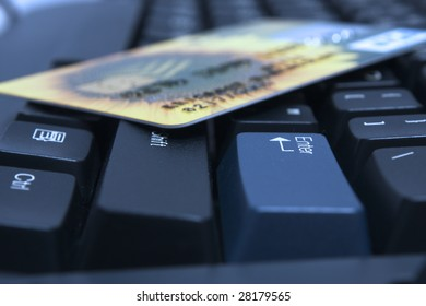 Credit card on a computer keyboard near to enter  key