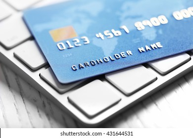 Credit card on keyboard, closeup