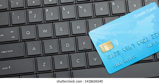 Credit card on keyboard with laptop. Online payment for purchases from online stores. Online shopping.