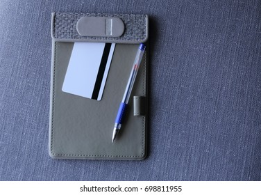 credit card  on a plate with a clip with pencil and marker isolated