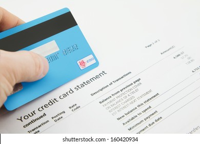 A Credit Card on top of a fake Bank Statements