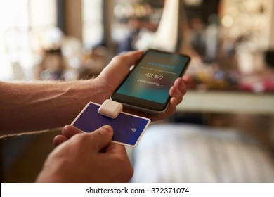 Credit Card Payment App Attached To Mobile Phone