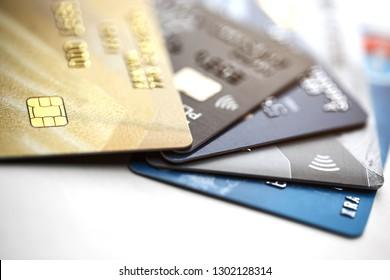 Credit card payment with close up shot isolated on white background,selective focus. Stack of credit cards