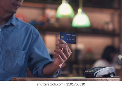 Credit card payment, Hand of male paying with a credit card reader machine