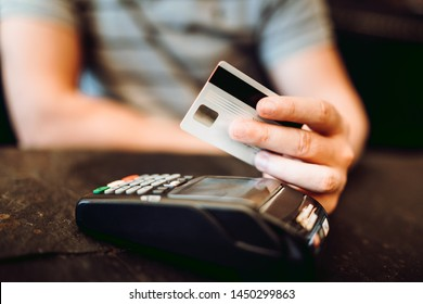 Credit card payment at restaurant. Man paying for lunch with credit card