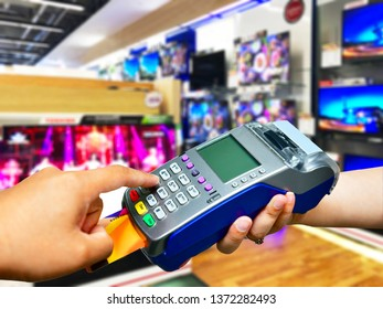Credit card payment at Television Retail shop