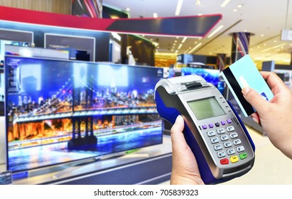 Credit card payment at Television Retail shop.