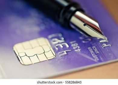 Credit card and pen.
