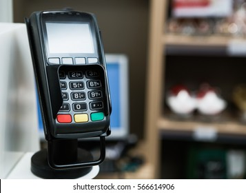 Credit card pos terminal machine at checkout in shopping center.Pay with cards or wireless mobile smart phone NFC payment technology.Check out payment system in a supermaket store