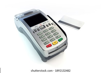 credit card reader pos machine and a silver credit card are isolated on white table background in the shopping shop mall department store grocery shop during doing buying and selling with credit card