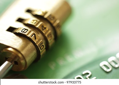Credit card security concept with combination lock padlock
