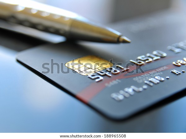Credit card with silver colored ballpoint pen