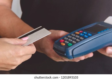 Credit card swipe through terminal for sale in store. Shopping and retail concept.