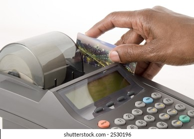A credit card is swiped in a credit card machine