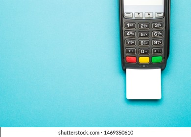 Credit card terminal on blue background with copy space. Modern and minimal style. Minimal concept.. Close up of merchant  payment device, card machine.