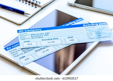 Credit cards with airline tickets for vacations on table background