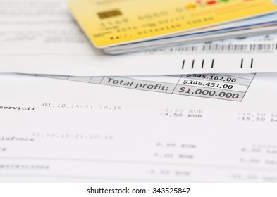 Credit cards, banking expenses and bank invoice. Very shallow depth of field.