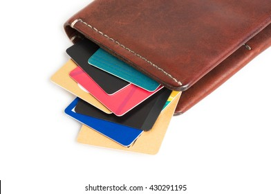 Credit cards in brown leather purse isolated on white background