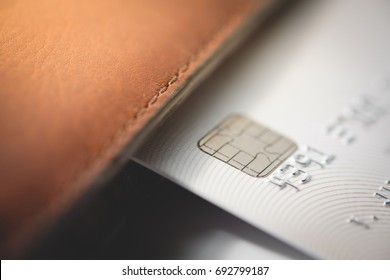 Credit cards in brown wallet with shallow focus, toned picture