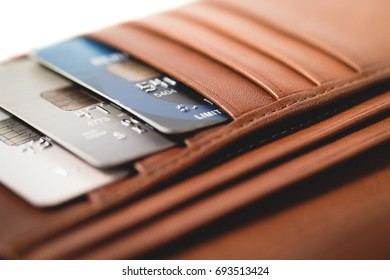 Credit cards in brown wallet with shallow focus