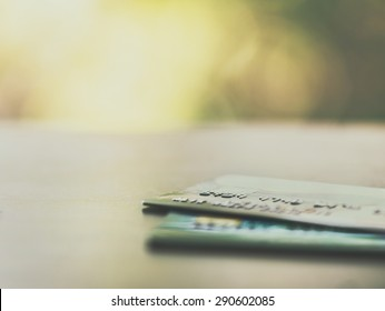 Credit cards up close with colorful bokeh - Split toned