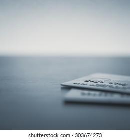 Credit cards up close on a desk - Split toned