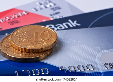Credit cards and coins euro cent macro.
