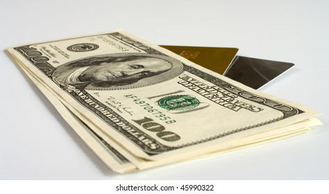 Credit cards and dollars on a white background.