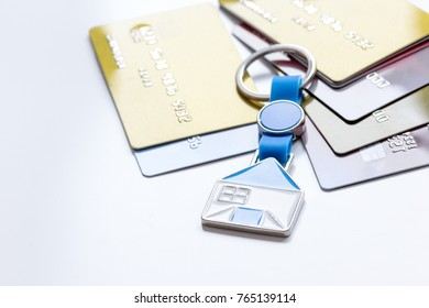 credit cards, key ring - concept mortgage on white background