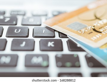 Credit cards laying on a keyboard