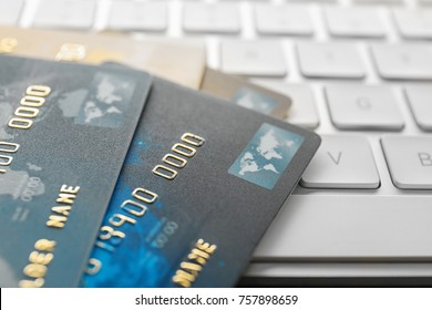 Credit cards on computer keyboard, closeup