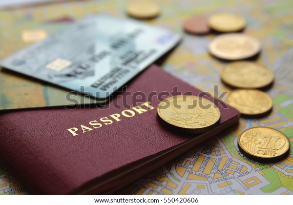 credit cards, passport, coins and map, close-up view. travel concept.