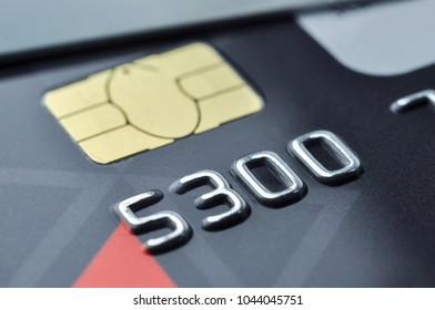 Credit cards and smart chip with shallow depth of field. Macro shot.