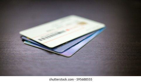 credit cards stack on dark color wooden table