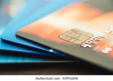 Credit cards stacked, old credit cards in brown and blue color