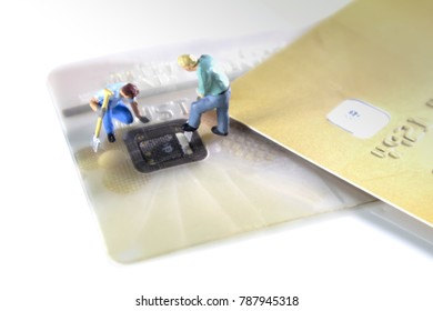 Credit Cards Theft Concept. Mini figures hacker steal Credit Cards  information on ship card Usecurity  For Unauthorized Shopping. Unauthorized Payments on white background