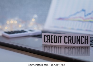 Credit Crunch business finance doom gloom concept with laptop and stock chart