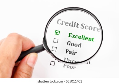 Credit score form with hand holding magnifier glass.