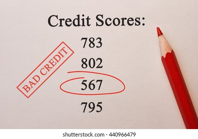 Credit Scores 567 in red circle with pencil on textured paper