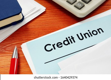 Credit Union papers for loan on desk.